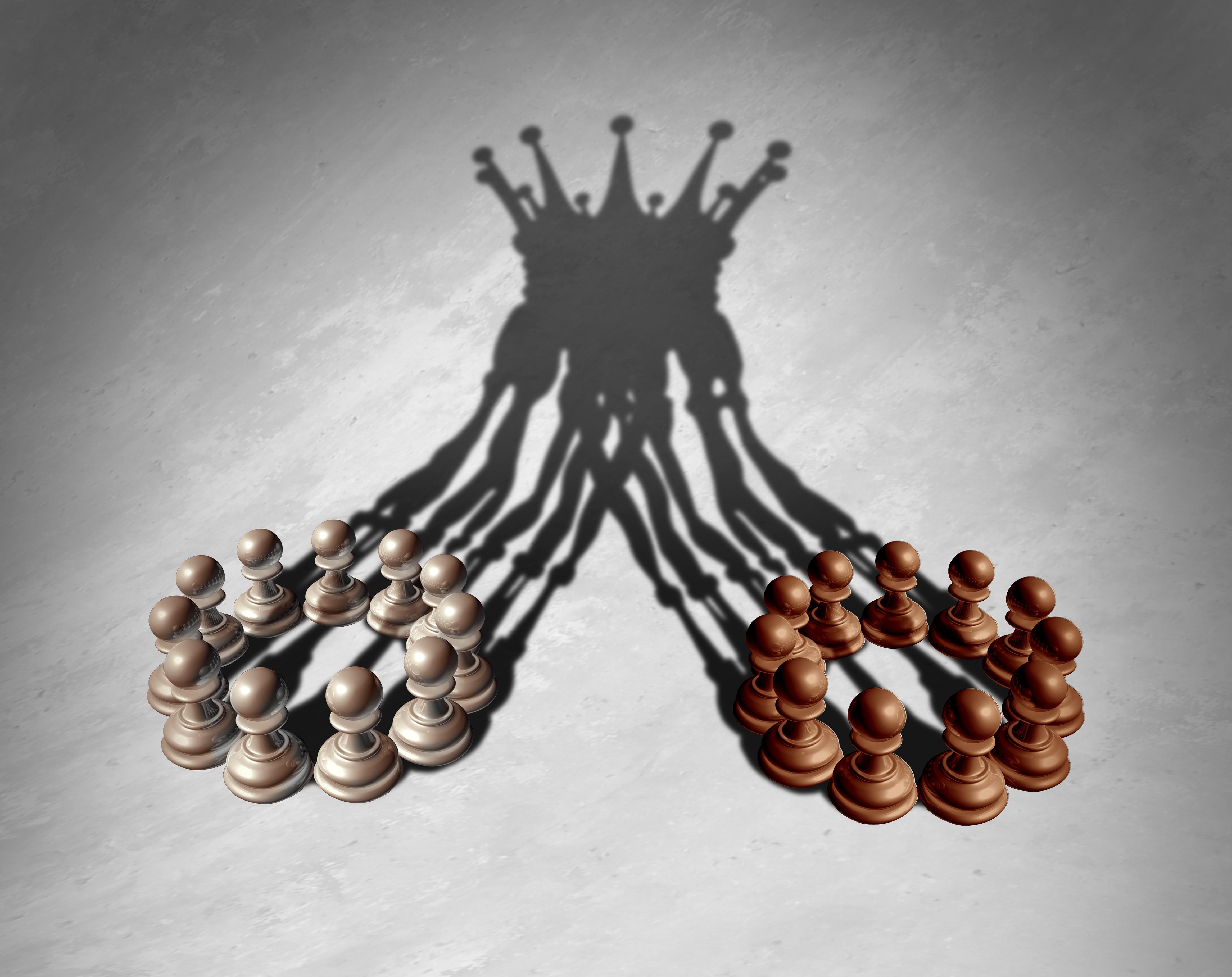 Bir kral tacını oluşturan satranç piyonlarının görüntüsü, bir birleşmeyi temsil etmek için gölge düşürdü.